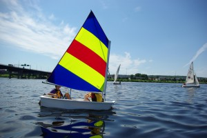 Youth sailing on the river